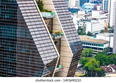Pathum Wan District,Phloen Chit Road,Bangkok,Thailand on March 16,2019:close up the exterior of Rosewood Bangkok with a visually stunning,vertical architectural marvel.