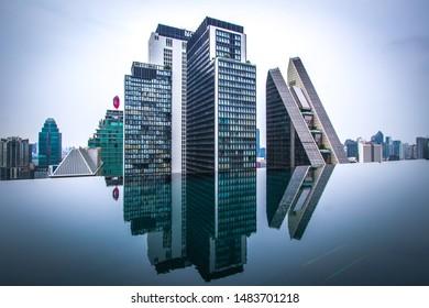 Pathum Wan,Bangkok,Thailand on March 16,2019:Beautiful landscape,showing swimming pool of The Okura Prestige Bangkok,Noble Ploenchit condominium,Rosewood Hotel & Resort and Bangkok skyline.