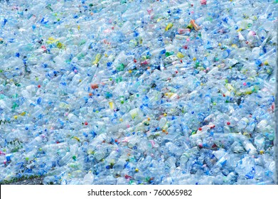 PATHUMTHANI PROVINCE,THAILAND-MAY 31: Big pile of waste plastic bottles in the factory to wait for recycle on may 2015 in PATHUMTHANI PROVINCE IN THAILAND