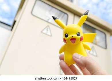 PATHUMTHANI, THAILAND - JULY 30, 2016 : Closed up of Pikachu on blur Danger High Voltage sign on cabinet power. Pikachu is electronic type pokemon. Concept of Pokemon, a big hit app after its launched
