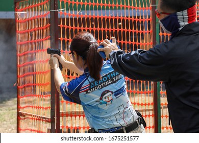 PATHUMTHANI - THAILAND, MAR 17,2020 : International Defensive Pistol Association school, the student shoot a gun in targets while teacher measuring time and scores in Pathumthani Thailand.