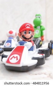 Pathumthani, Thailand - Sept 17, 2016 : Super Mario (Mario Kart) from Super Mario video game console developed by Nintendo EAD. Toy set from McDonalds Happy Meal.Mario Run game will launch in Dec 2016