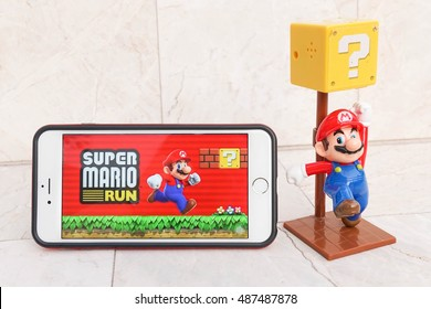 Pathumthani, Thailand - Sept 17, 2016 : iPhone6 with the Super Mario game app on the touch screen, on marble background. Super Mario Run game will be launched in Dec 2016.