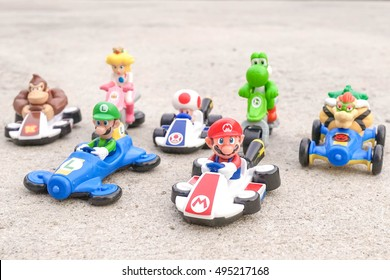 Pathumthani, Thailand - Sept 17, 2016 : Super Mario and friends from Mario Kart, Go-Kart-Style racing VDO game developed by Nintendo. Toys from McDonalds Happy Meal for kids set. Racing game concept.