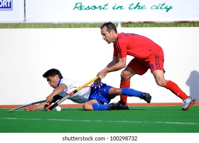 PATHUMTHANI THAILAND-APRIL16:Douglas Corbel (R) of HKG in action during The Fourth men's ptt AHF cup betaween HKG(R) and UZB(W) at  Queen Sirikit Sports Stadium on April 16,2012 in Thailand