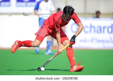 PATHUMTHANI THAILAND-APRIL16:Ka Ho Chan of HKG in action during The Fourth men's ptt AHF cup betaween HKG(R) and UZB(W) at  Queen Sirikit Sports Stadium on April 16,2012 in Thailand