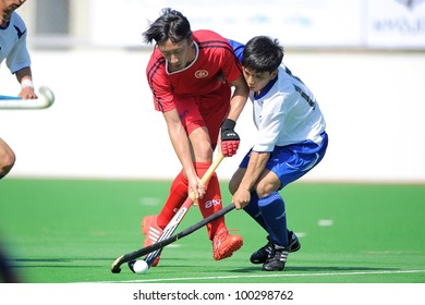 PATHUMTHANI THAILAND-APRIL16:Ka Ho Chan (red) of HKG in action during The Fourth men's ptt AHF cup betaween HKG(R) and UZB(W) at  Queen Sirikit Sports Stadium on April 16,2012 in Pathumthani Thailand