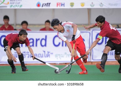 PATHUMTHANI THAILAND-APRIL17:Ka Ho Chan (W) of HKG in action during The Fourth men's ptt AHF cup betaween HKG(W) and KAZ(R) at Queen Sirikit Sports Stadium on April 17,2012 in Pathumthani Thailand