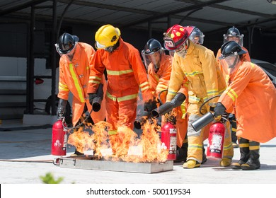 PATHUMTHANI, THAILAND-OCTOBER 14,2016: Many people preparedness for fire drill and training to use a fire safety tank in the factory.