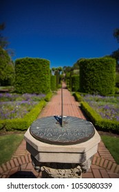 Pathway in a Beautiful Landscape Garden with Sundial