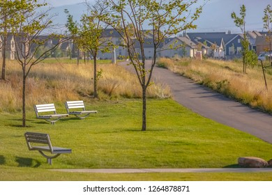 Pathway and benches on a park in Daybreak Utah