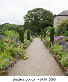 Pathway Between Herbaceous Borders in the Hidden Garden at Plas Cadnant by Menai Bridge on the Isle of Anglesey, Wales, UK
