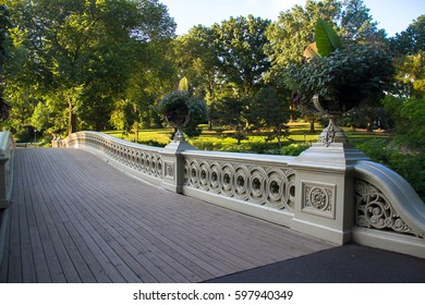 Pathway and fence of Bow bridge and trees at Central Park