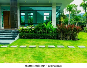Pathway in garden, Green lawns with bricks pathways, Modern house with beautiful landscaped front yard