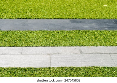 pathway in the green grass