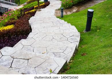 Pathway leading through a garden.