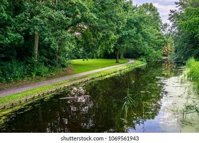 Pathway next to a pond at Haagse Bos, forest in The Hague, Netherlands, Europe