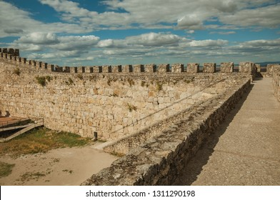 Pathway on top of thick stone wall with crenel and merlons at the Castle of Trujillo. A small medieval town, birthplace of the Conquistador Francisco Pizarro in western Spain.