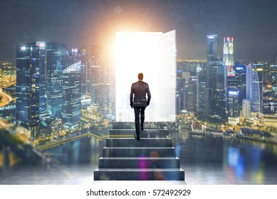 Pathway of opportunity. Back view of man exiting abstract night city room with stairs to enter open door with bright light. Success concept