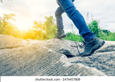 Pathway to success concept a man walk on broken concrete stone road go to the light at the destination  with space area for write some text on background meaning walk to success concept