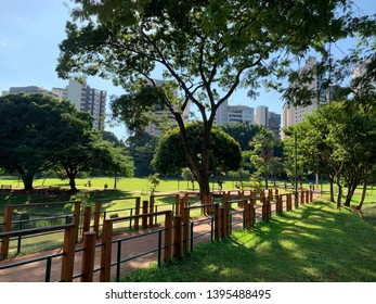 Pathway surrounded by a wodden fence at a conservation park in Goiania, Goias, Brazil