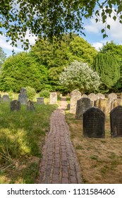 A pathway through a tranquil churchyard in Sussex