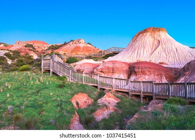 Pathway with wooden stairs to Sugarloaf in Hallett Cove at dusk, South Australia