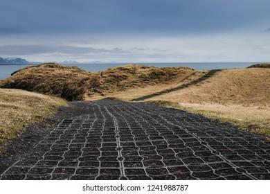 Pathways around the Arnarstapi cliffs, well known landmark in west Iceland
