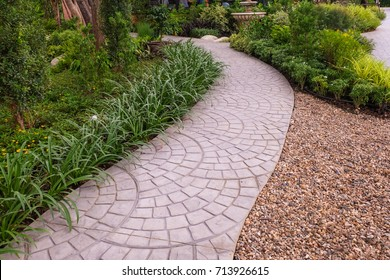 Pathways with green lawns, Landscaping in the garden,curve walkway on green grass field .