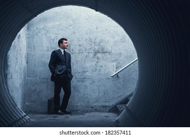 Patience is a virtue - Businessman waiting for something or someone in a tunnel