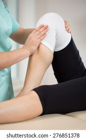 Patient after knee injury exercising with physiotherapist