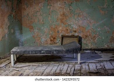 Patient chamber, cabinet with old bed in abandoned sludge treatment sanatorium in Baldone city, Latvia