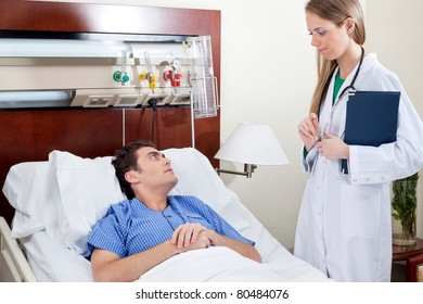 Patient consulting doctor in hospital room