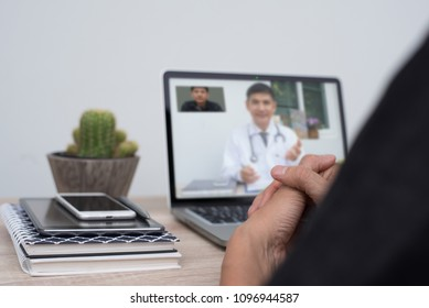 Patient consulting doctor via laptop computer at home or office, telemedicine, e health. Man having video chat with friendly doctor, medical online concept