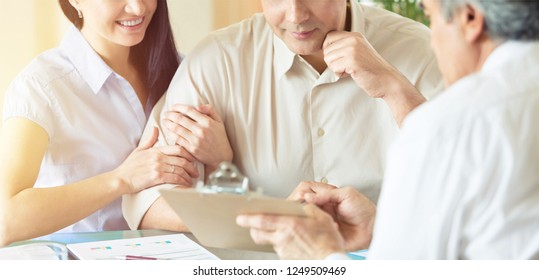 Patient couple consulting with doctor or psychologist