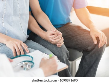 Patient couple having doctor or psychologist consulting on marriage counseling, family medical healthcare therapy, IVF insemination fertility treatment for infertility or psychotherapy session concept