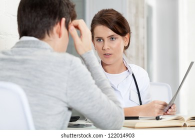 Patient and doctor discussing x-ray results