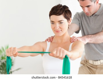 Patient doing some special exercises under supervision in a room