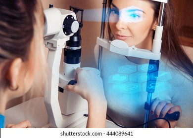 patient during an eye examination at the eye future clinic. Ophthalmologist. Virtual sensors for vision checking. Future medicine and health concept.