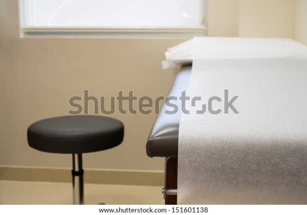 Patient examination table in a doctors office.