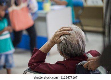 Patient hand on head waiting for treatment  in the hospital.