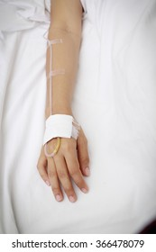 patient in hospital with saline intravenous (iv) - Shutterstock ID 366478079