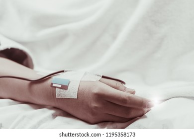 Patient in hospital therapy recovery on bed room blood donation and saline bag drip fluid machine for serious diagnosed coma emergency sick case, thalassemia treatment, cancer chemotherapy, surgery