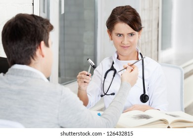 Patient joshing doctor with nail