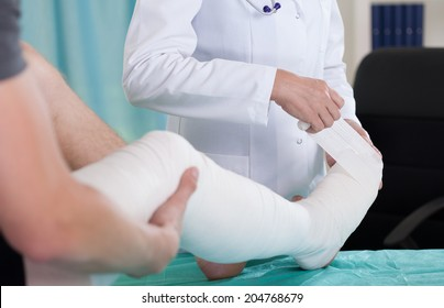 Patient with leg in a plaster cast
