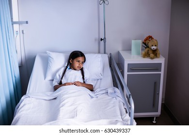 Patient lying on bed at hospital