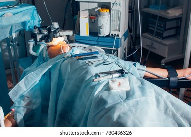 Patient lying on the bed restraint the arm with cotton on operating table