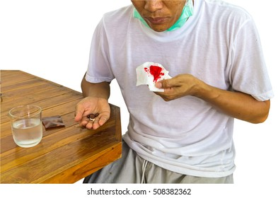 Patient man of Tuberculosis with anti Tuberculosis drugs on hand and hemoptysis on white background.Saved with clipping path.