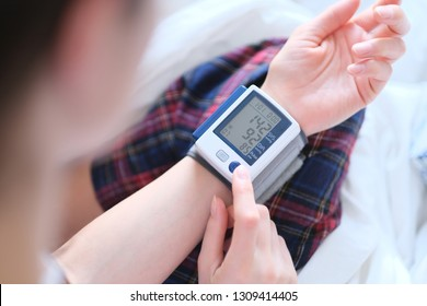 Patient measuring blood pressure. Hypertension.