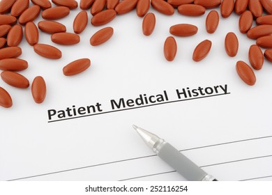 patient medical history document with pills and pen